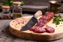 Salami and knife on a cutting board