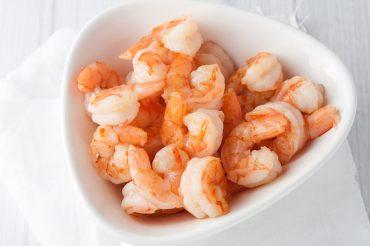 fresh cooked shrimp in white bowl