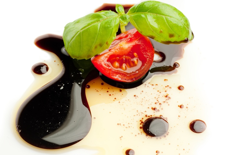 tomato and basil over olive oil and balsamic vinegar