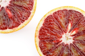 Two Blood Oranges in Half closeup on white background