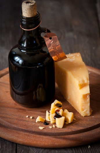Delicious parmesan cheese and bottle of old balsamic vinegar